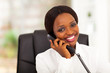 pretty female african office worker talking on phone