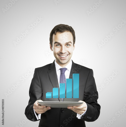 businessman hold tablet with growth chart