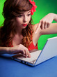 Colorful portrait of  young woman working on a laptop