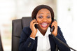 funny african american businesswoman talking on two phones