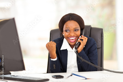 african american businesswoman receiving excited news