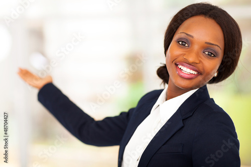 cheerful african american businesswoman presenting