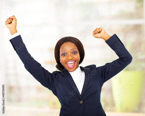 cheerful african american businesswoman in office