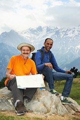 two smiling tourist hiker in india mountains