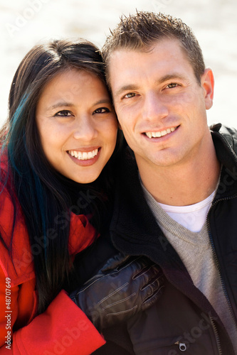 Cute diverse couple in the snow portrait
