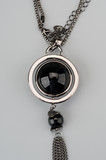 Silver pendant with large black gem poster