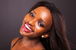 happy young african american woman face closeup