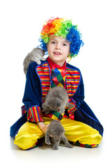 Boy clown training kittens  over the white background