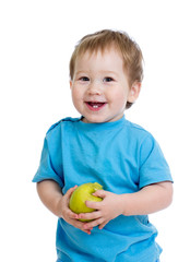 Baby boy holding and eating green apple, isolated on white