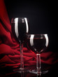 Red wine glass and bottle on a silk background