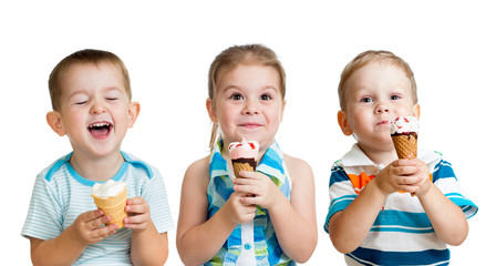 happy children boy and girls eating ice cream in studio isolated