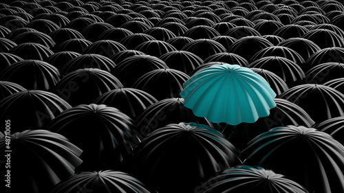 Standing out from the crowd, color umbrella over many dark ones