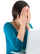Young tired woman face palm working on laptop