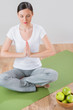 Portrait of beautiful young woman doing yoga exercise - Meditati