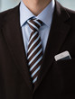 Closeup of torso of confident business man wearing elegant suit