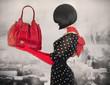 Art photo elegant lady holding a bag.