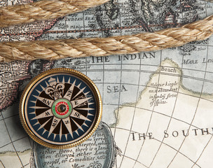 Vintage compass and old map