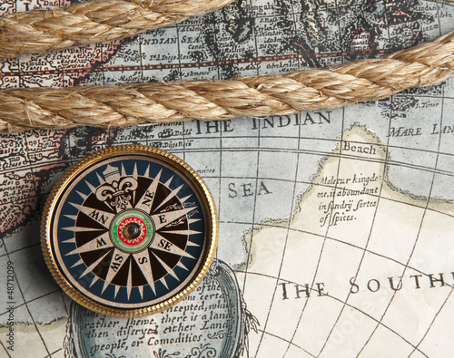 Vintage compass and old map - 48712099