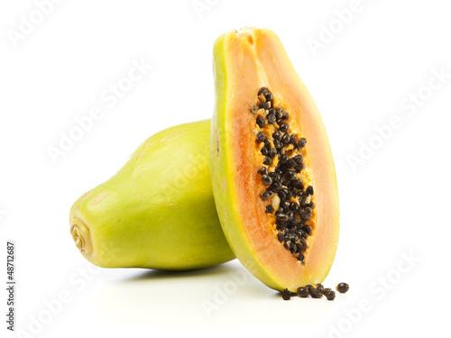 Whole and half Papaya fruit isolated