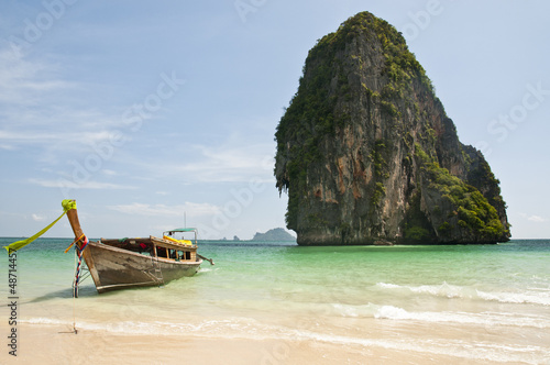 Long tail boat and limestone rock in the Andaman Sea - Thailand