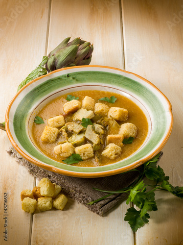 artichoke soup with toasted sliced bread, vegetarian food