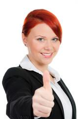 rothaarige geschäftsfrau zeigt daumen hoch