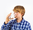 boy drinking water out of a glass