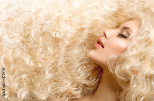 Poster Curly Hair. Fashion Girl With Healthy Long Wavy Hair
