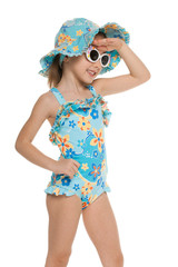 Little girl in a swimsuit looking away