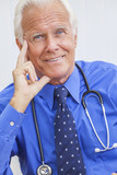Smiling Senior Male Doctor With Stethoscope