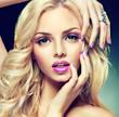 Beautiful blonde girl with lilac makeup