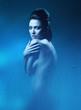 sexy brunette woman in dark blue shower