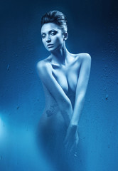 erotic beautiful woman in dark blue shower