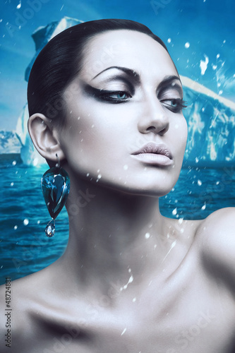 portrait of brunette winter woman with diamond earring