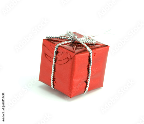 Red gift tied up by a ribbon