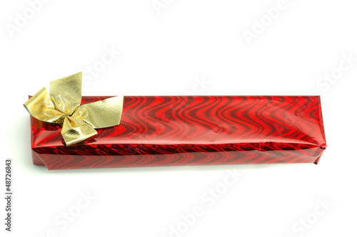 Red gift with a gold bow