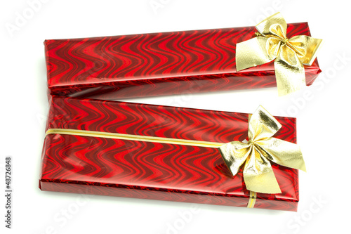 Red gifts with gold bows