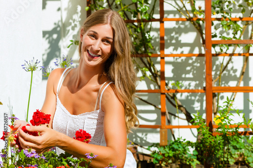 Woman gardener looking after flowers