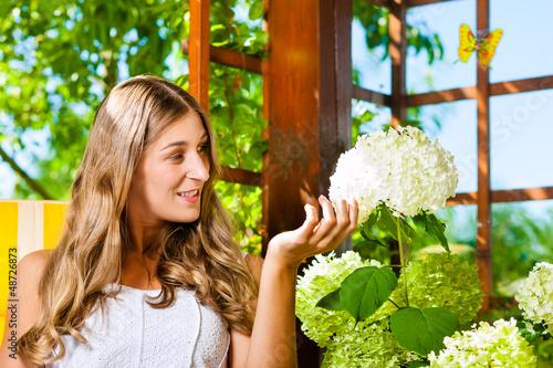 Woman tanning in the sun in her garden