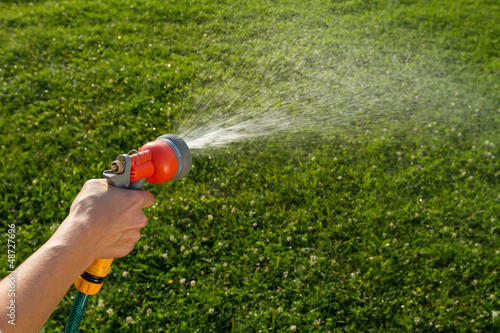 Watering the lawn with spray gun