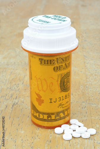 pill bottle with money