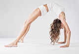 Fototapety Young sporty woman doing stretching exercise. Backbend.