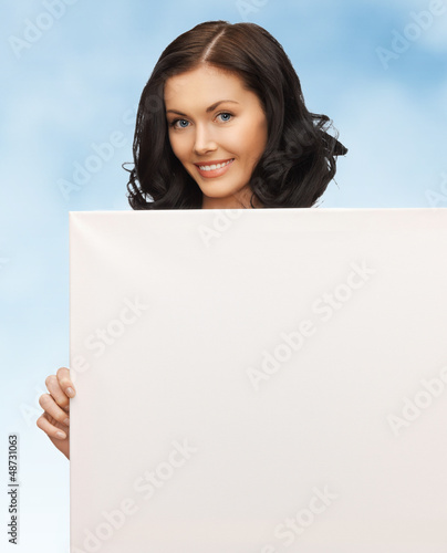 lovely woman with blank board