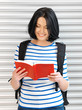 woman with bag and book