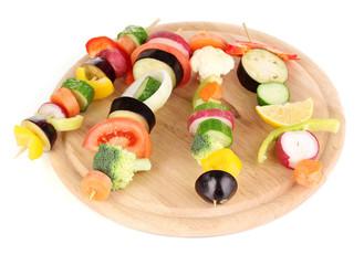 Sliced vegetables on wooden picks isolated on white