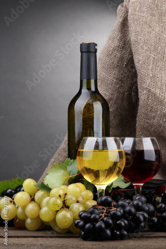 bottles and glasses of wine, cheese and grapes