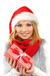 Attractive young woman holding Christmas gift, isolated on