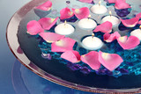 Rose petals and candles in water in vase - 48731867