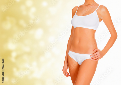 Female shapes against abstract golden blurred background