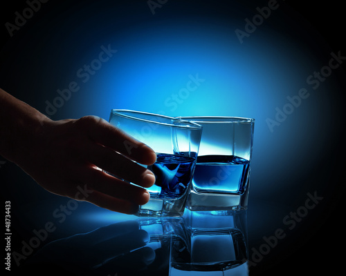 Two glasses of blue liquid